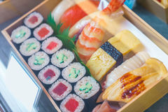 ,Plastic Sushi rolls in a display case Stock Image