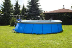 Plastic swiming pool. In the garden Royalty Free Stock Photography