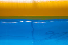 Plastic swimming pool with blue water Stock Photos