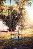 Plastic swing in the park. stock images