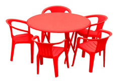 Plastic table and chairs - red Royalty Free Stock Images