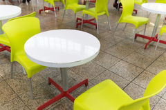 Plastic tables and chairs in cafe Royalty Free Stock Images