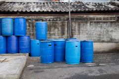 Plastic tanks or 200 liter plastic tank used as trash. Plastic tanks or 200 liter plastic tank used as trash in a community area Royalty Free Stock Image
