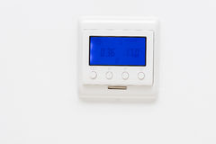 Plastic thermostat on a plain white wall Stock Photo