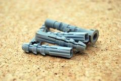 Plastic toebehoren voor schroeven stock afbeelding