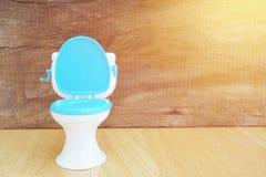 Plastic toilet  toy on wood Stock Photos