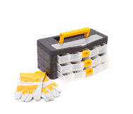 Plastic tool box and leather gloves. Royalty Free Stock Photo