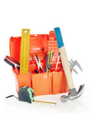Plastic toolbox with various working tools isolated over white Stock Photos