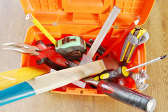 Plastic toolbox with various working tools Royalty Free Stock Images