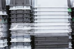 Plastic tote boxes. Used in the food industry for storing and transporting raw materials stock photos