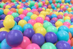 Plastic toy balls in Ball pool playground Stock Photos