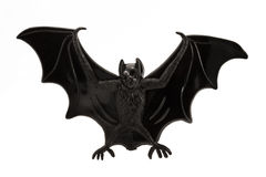 Plastic toy bat over white Stock Images