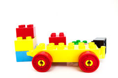 Plastic toy blocks on white background. For child and girl Stock Image