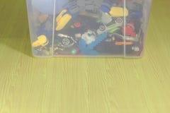 Plastic toy box on yellow wooden floor stock photos