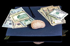 Plastic toy brain on a college graduation cap Stock Photos