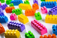 Plastic toy building blocks. On white royalty free stock photography