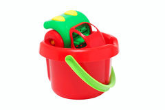 Plastic toy car inside the bucket. Royalty Free Stock Images