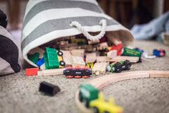 Plastic Toy Car Scattered on Brown Textile Stock Photography