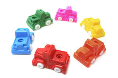 Plastic Toy Cars Arranged in Circle Royalty Free Stock Images