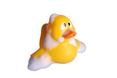 Plastic toy duck with soap bubble Royalty Free Stock Photos