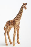 Plastic toy giraffe. Close up of a plastic toy giraffe isolated on white background Stock Image