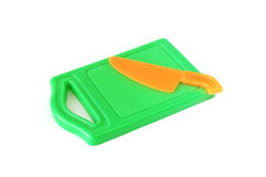 Plastic toy green chopping board and orange knife Royalty Free Stock Photography