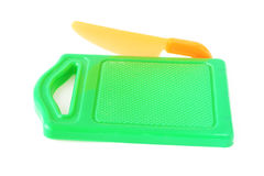 Plastic toy green chopping board and orange knife Stock Image