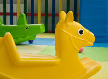 Plastic toy horse-chairs and crocodile royalty free stock photo