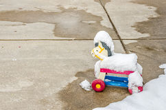 Plastic Toy Horse. Left outside and covered with snow Royalty Free Stock Photography
