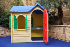 Plastic toy house. Life size for kids Royalty Free Stock Photography