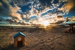 Plastic toy house on the beach Stock Photos