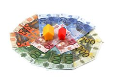 Plastic toy houses on money Stock Photo