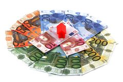 Plastic toy houses on money Royalty Free Stock Image