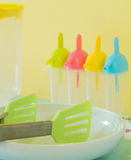 Plastic toy kitchen utensils and tableware toys on a table Stock Photo