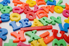 Plastic Toy Letter Spelling. A colorful group of plastic letters spelling the word learn. Education concept royalty free stock image