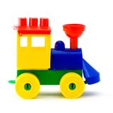Plastic toy  locomotive. A coloured toy  locomotive  made of plastic details for designing isolated on white background Royalty Free Stock Photos