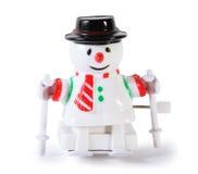 Plastic toy mechanical snowman on skis isolated. White plastic toy mechanical snowman on skis isolated on white background stock illustration