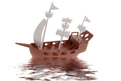Plastic toy pirate ship with reflection Stock Photos