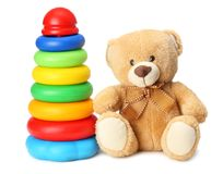 plastic toy pyramid with toy teddy isolated on white background royalty free stock photography