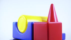 Plastic toy set of dice. Rotation of children`s plastic toy set stock video footage
