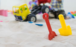 Plastic Toy Shovel in a Sand box playground toy truck. Stock Photo