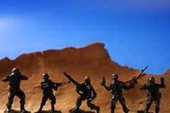 Plastic toy soldier over wooden mountain Royalty Free Stock Photos