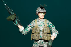 Plastic Toy Soldier. Wielding a gun Stock Photos