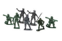 Plastic toy soldiers on white Stock Photos