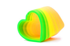 Plastic toy spring in heart-shaped Royalty Free Stock Photos