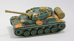 Plastic toy tank. Closeup of a plastic toy tank on a white background Stock Image