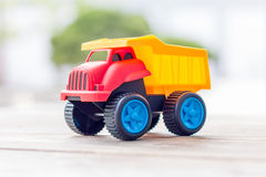 Plastic toy truck on a wooden background. Closeup Royalty Free Stock Image