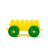 Plastic toy  vehicle. A green and yellow toy  vehicle made of plastic details  for designing isolated on white background Stock Photos