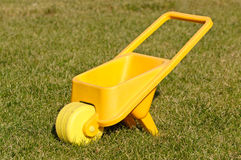Plastic toy wheelbarrow Royalty Free Stock Photos