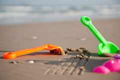 Plastic toys on the beach Stock Images